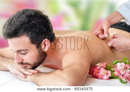 Young Man Enjoying Back Massage.