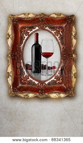Bottle And Glass Wine In Old Picture Frame On Marble Background