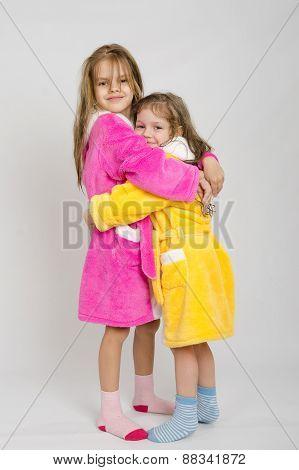 Two Sisters Hug After A Bath