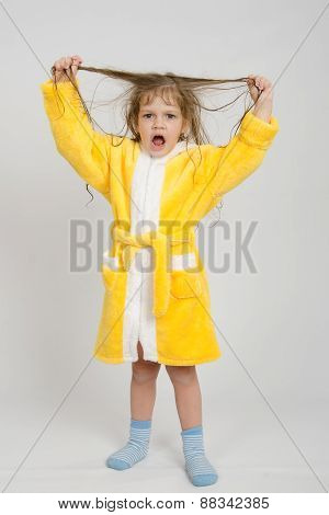 Girl In A Yellow Robe Lifted Wet Hair