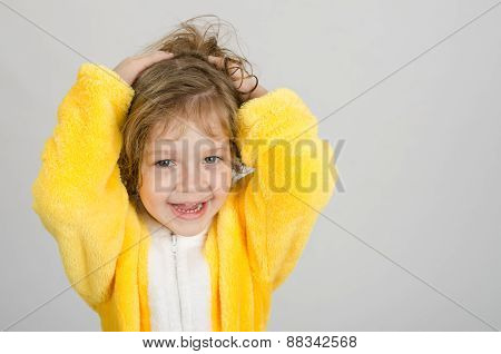 Joyful Girl In A Yellow Bathrobe