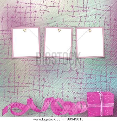 Gift Box In Pink Wrapping Paper On Vintage Cardboard Background With Frames