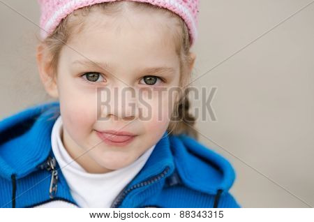 Portrait Of Four-year Girl In A Hat