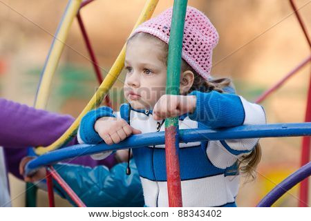 Four-year Girl Thought Playing On The Playground