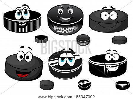 Cartoon black ice hockey pucks characters