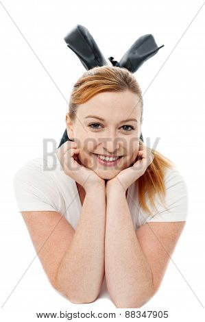 Smiling Woman Relaxing Laid On Floor