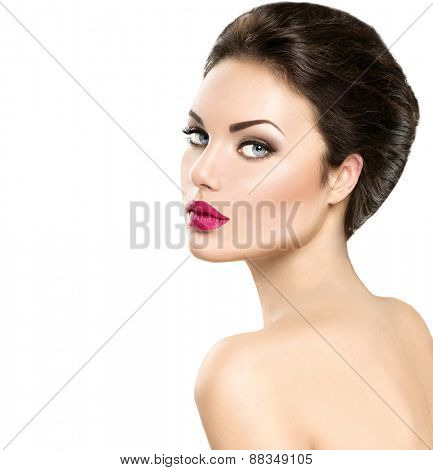 Beauty woman portrait isolated on white background. Beautiful model girl face makeup. Gorgeous lady with blue eyes and brown hair. Perfect skin. Professional make up. Red lips