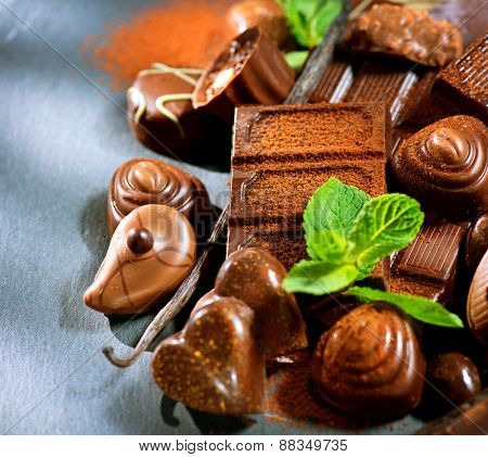 Chocolates. Chocolate sweets. Assortment of fine chocolates in dark and milk chocolate with vanilla and mint. Praline
