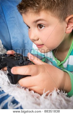 Little boy playing video games