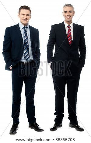 Business Partners Posing Over White