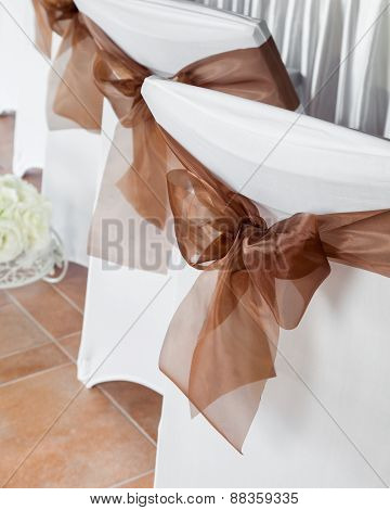 Wedding Chair With Brown Ribbon.