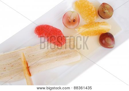 small cream cake slice with tangerine and grapefruit