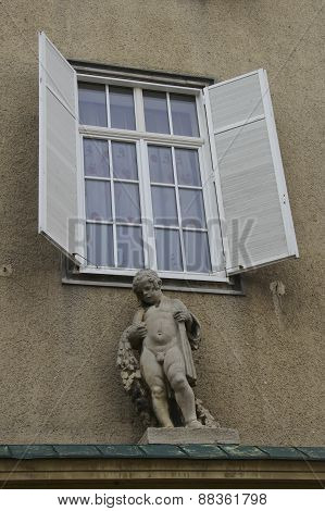 Boy Sculpture On Facade