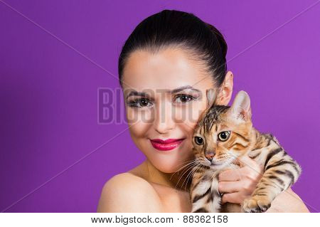 The girl with a cat. Cat Bengal breed