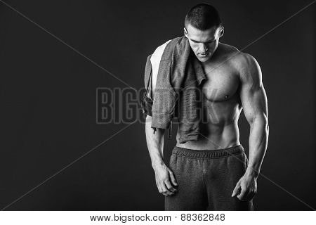 Bodybuilder showing his press. A man shows his abdominal muscles, raised his hand t-shirt. Presss,