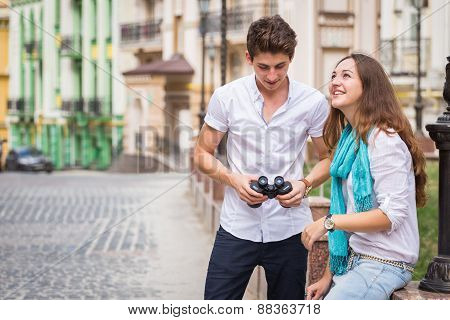 Girl and guy on the streets of European cities. Couple walking along the picturesque street.