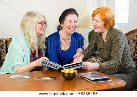 Adult Women Friends Laughing At Old Photos