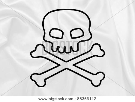 Jolly Roger waving flag on silk texture