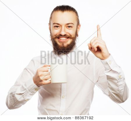 bearded young man drinking coffee and showing thumb up.