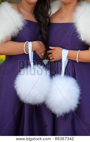 Two Bridesmaids In Purple Holding White Feather Pom Poms