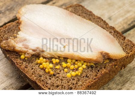 Close Up Image Bacon Sandwich With Mustard.