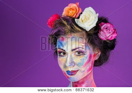 Artistic work of make-up artist. Flower girl. Roses woven into the hair model.