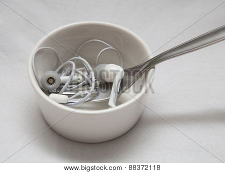 Earplugs with fork in little bowl