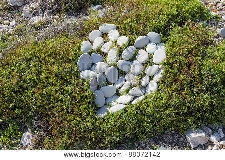 Stones heart on the grass