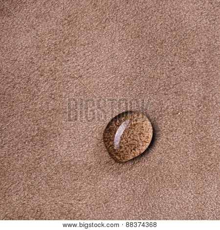 macro photo of water drop on brown leather background
