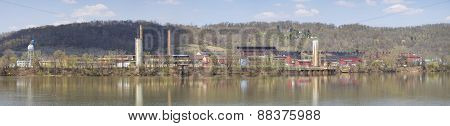 Factory and Industrial Area along a River. Panorama.