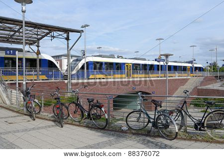 KEMPEN, GERMANY - JUNE 29, 2013: Bicycles against a modern commuter train. Germany implements the National Cycling Plan to increase the bicycle share of urban trips