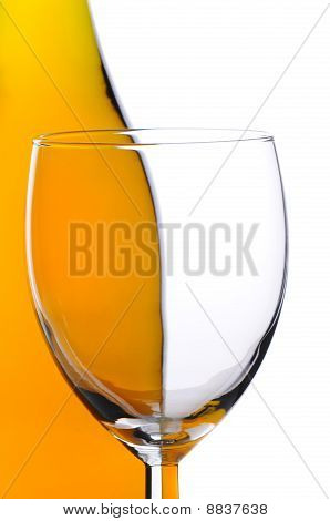 Wine Glass In Front Of Bottle