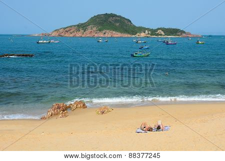 Tourists Enjoying On Beautiful Beach