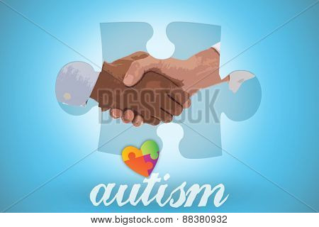 The word autism and close-up shot of a handshake in office against blue background with vignette