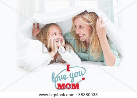 mothers day greeting against mother and daughter looking at each other under the duvet