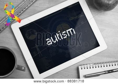 The word autism and autism awareness ribbon against medical biology interface in blue