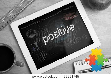The word positive and autism awareness jigsaw against medical biology interface in black