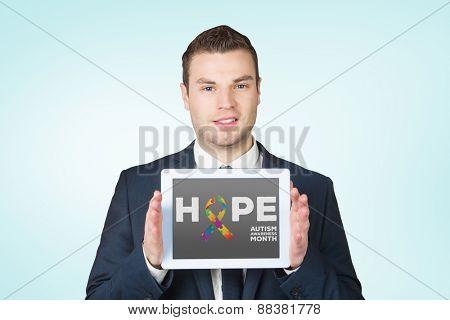 Businessman showing tablet pc screen against blue vignette background