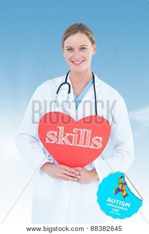 The word skills and doctor holding red heart card against blue sky