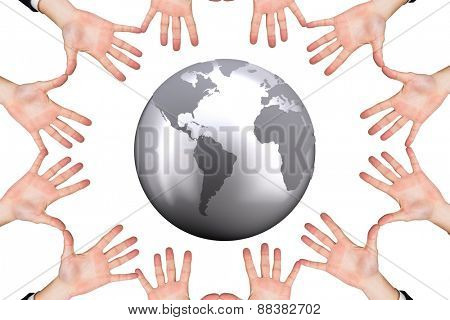 Circle of hands against silver earth
