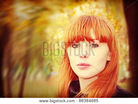 Pretty Red Hair Girl Looks At Camera.soft Bokeh.