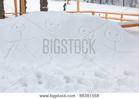 Smiling Stickman Family Drawn By Hand In Snow