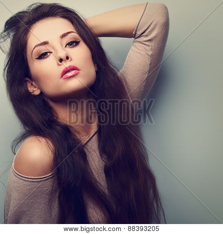 Sexy Makeup Female Model Posing With Long Hair And Pink Lips