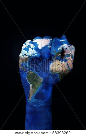 the raised fist of a young man patterned with a world map (furnished by NASA) on a black background depicting the concept of the ecologist movement or the empowerment of the ecologism
