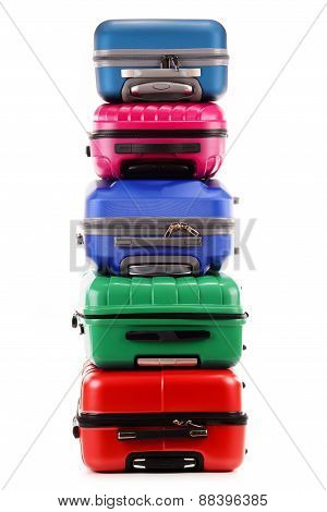 Stack Of Plastic Suitcases Isolated On White