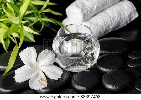 Spa Concept Of White Hibiscus Flower, Bamboo, Round Vase And Towels On Zen Basalt Stone With Drops,