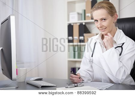 Female Physician On Her Table Writing Reports