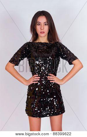 Beautiful brunette girl in a black dress.