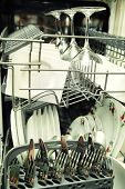 image of dishwasher  - details of Open dishwasher with clean utensils - JPG