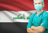 foto of iraq  - Surgeon with national flag on background  - JPG